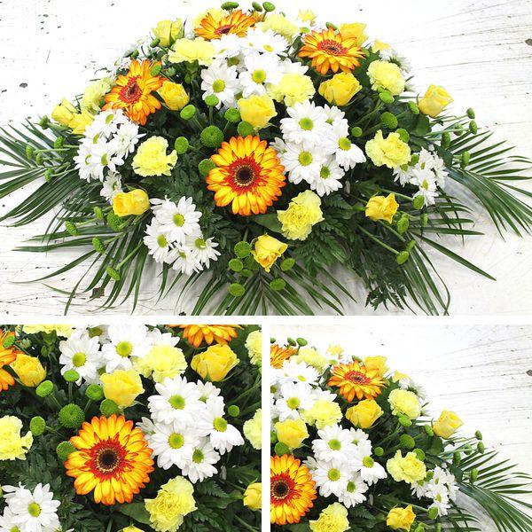 Centro de flores variadas amarillas
