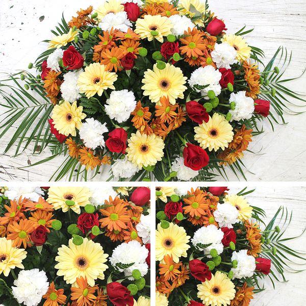 Centro flores variadas en tonos rojos y naranjas