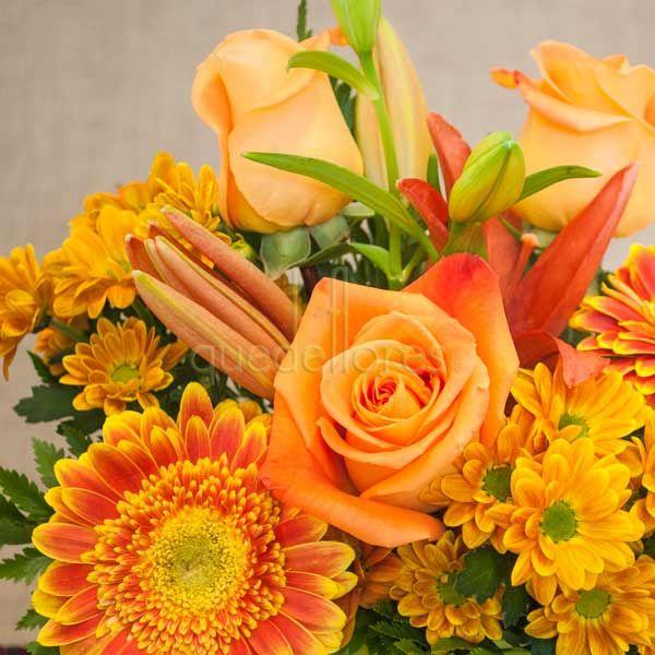 Cubito QDF de flores naranjas.